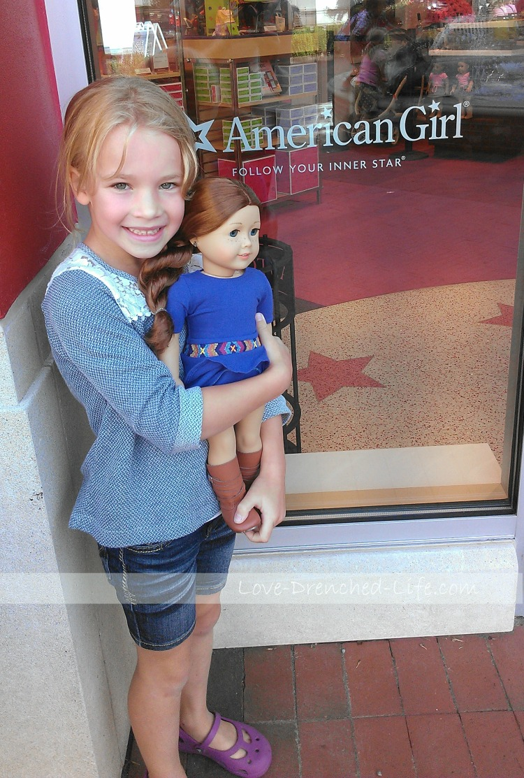 Anna and Saige, a doll she bought with her own money last August.